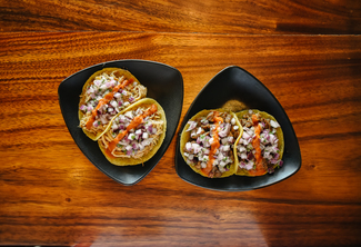Carne Asada Taco and Braised Carnitas Taco