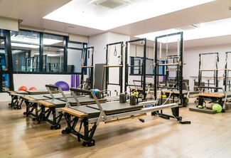 One STOTT Pilates Reformer Group Class